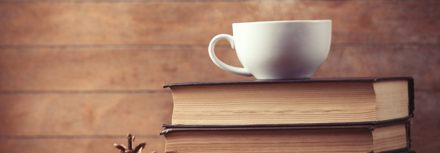 Book In One Hand Coffee In Another